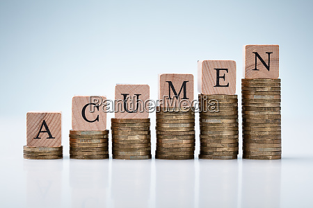 acumen text on stacked coins arranged