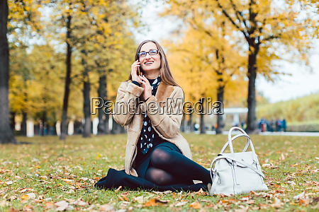 woman sitting in the grass in