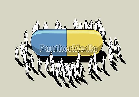 menschenmenge um grosse pharmazeutische kapsel