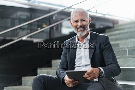 portrait of smiling mature businessman sitting