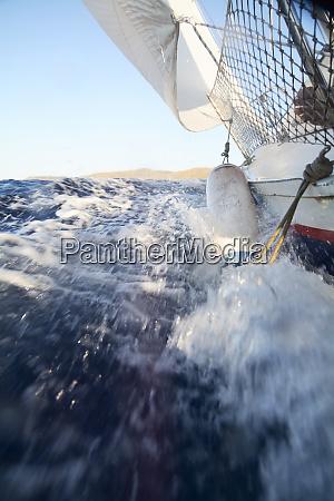 sailing boat splashing water menorca spain
