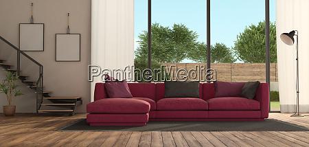 modernes wohnzimmer mit lila sofa und