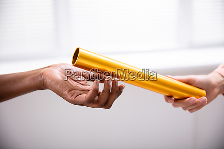 passing golden relay baton to other