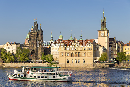 tourist boat on vltava river passing