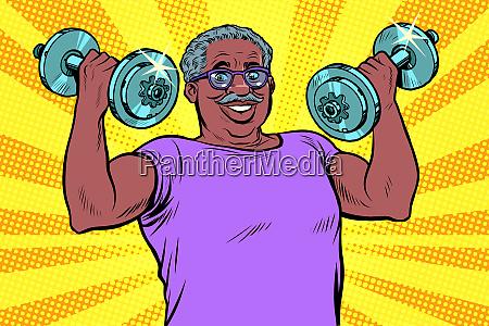 elderly african man lifts dumbbells fitness
