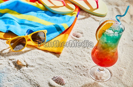 colorful tropical cocktail on a sandy