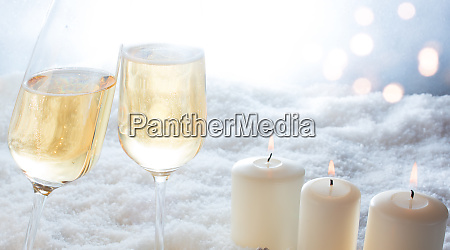 candles and champagne in winter