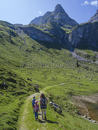 young family hiking around bannalp in