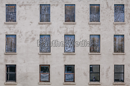 boarded up windows from an abandoned
