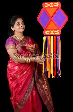 indian woman with diwali lantern
