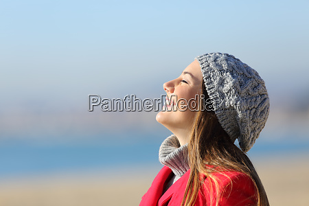 happy woman breathing deeply fresh air