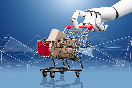roboter hand holding einkaufswagen gefuellt mit