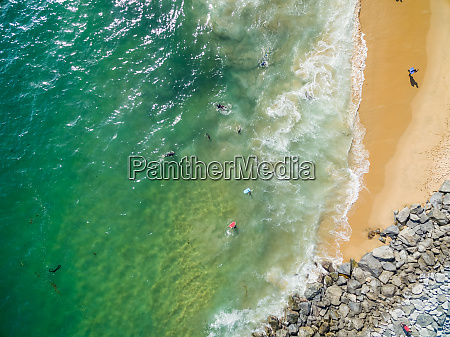 aerial view of surfers at newport