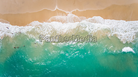 aerial view of people swimming in