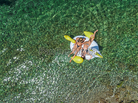 aerial view of two women floating