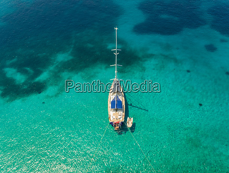 aerial view of sailboat anchored in
