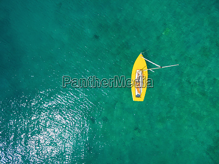 aerial view of yellow boat floating
