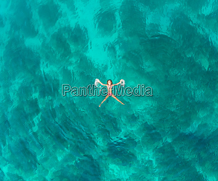 aerial view of young girl floating