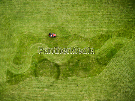 aerial, photography, of, man, on, lawnmower - 27455698