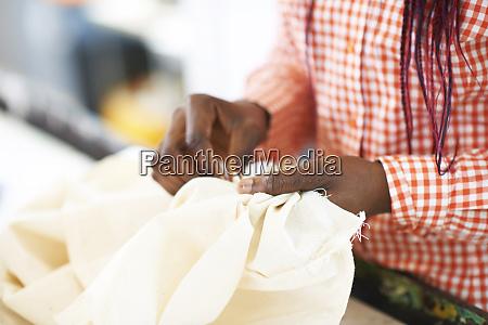 close up female fashion designer sewing