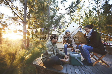 friends playing cards outside yurt at
