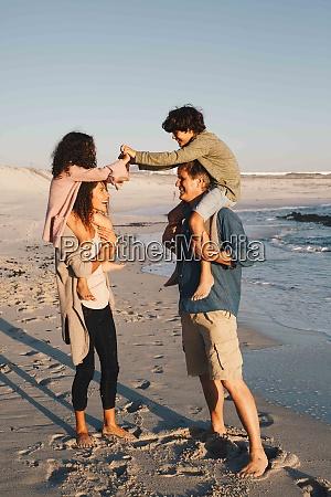 children piggyback fighting on parents at