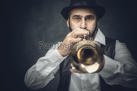 jazz trumpet player on a dark