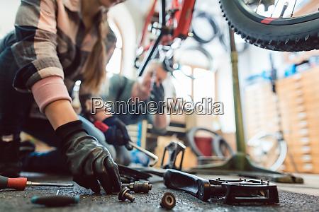 bike mechanic working on a bicycle