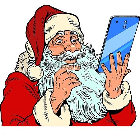 weihnachtsmann und ein grosses smartphone elektronische