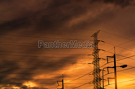 silhouette high voltage electric pylon and