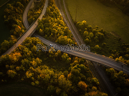 winding road in autumn forest at