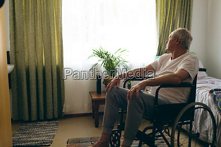 male patient looking outside the