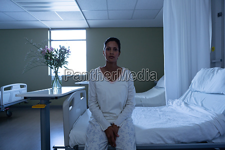female patient looking at camera while