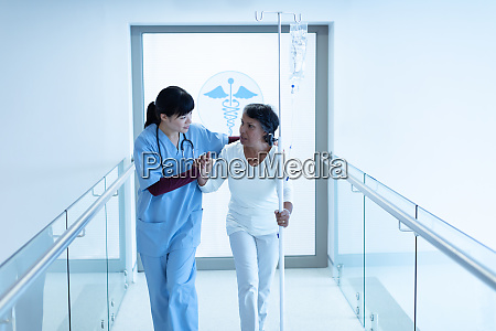 female doctor helping female patient to