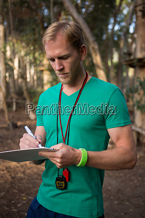 trainer holding notepad in his hands