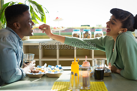 couple sitting together in restaurant while