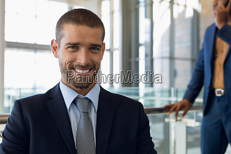 young businessman sitting in an office