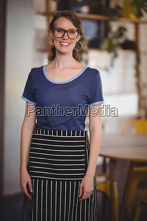 portrait of smiling young waitress wearing