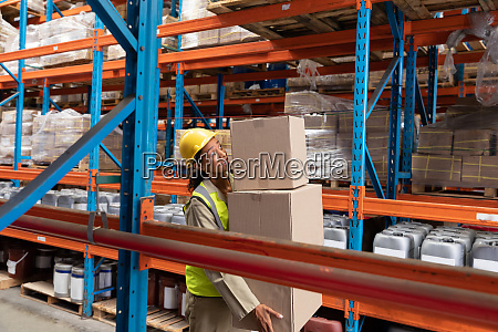 female staff carrying cardboard boxes in