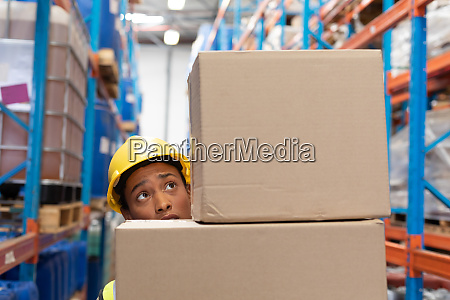 female worker carrying cardboard boxes in