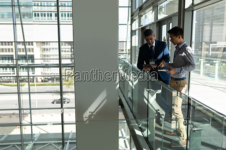 side view of two businessman looking