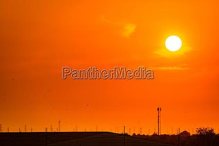 beautiful orange sunset sky with roof