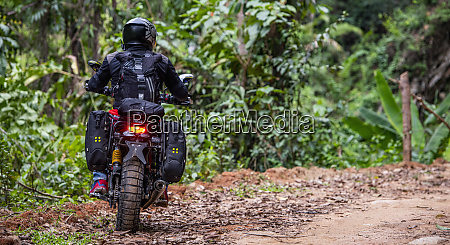 biker riding off road motorcycle on