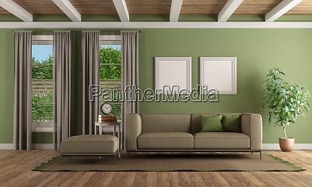 gruenes wohnzimmer mit modernem sofa und