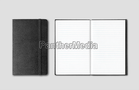 black closed and open notebooks isolated