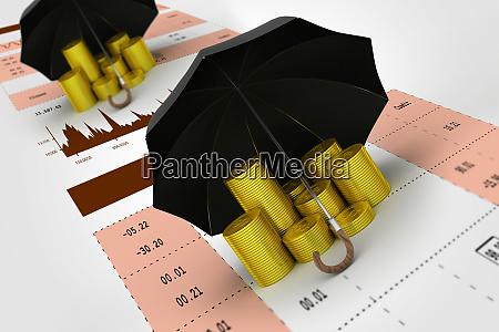 goldmuenzen unter einem schwarzen regenschirm mit