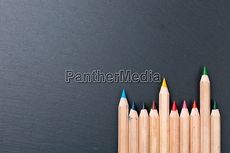 color pencils on chalkboard background copy