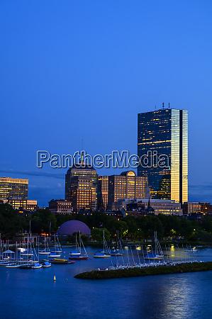 city skyline with harbor in boston