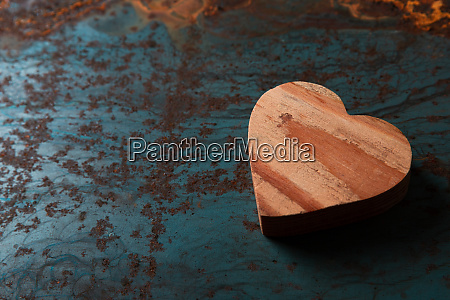 wooden heart on a metal background