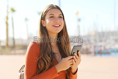 attractive young traveler woman using application